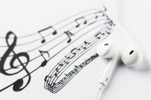 White earphones on music notes
